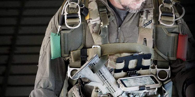 defense operator with chest mounted ATAK app on phone