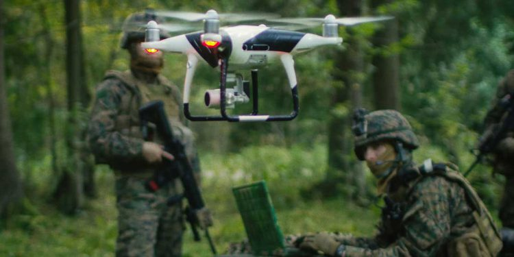 Defense operators with UAV in forest