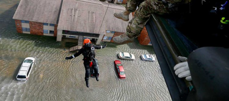 Rescue operation from helicopter in flood zone