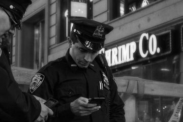 police officers with smart phones