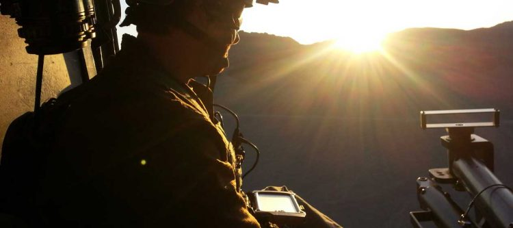 Soldier using smartphone before deployment