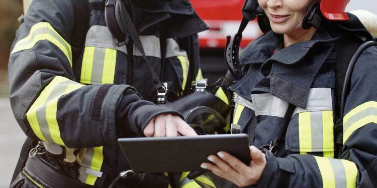 Firefighters looking at tablet